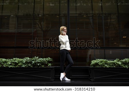 Full length portrait of gorgeous young woman talk on smart phone while look to the empty copy space area for your text message or information, female hipster at mobile phone conversation, filter image - stock photo