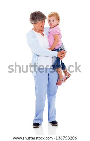 full length portrait of grandmother carrying her grandchild isolated on white