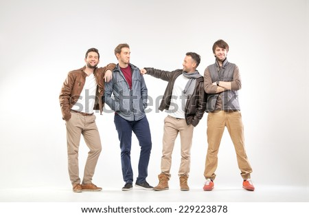 Full-length portrait of group of young men - stock photo