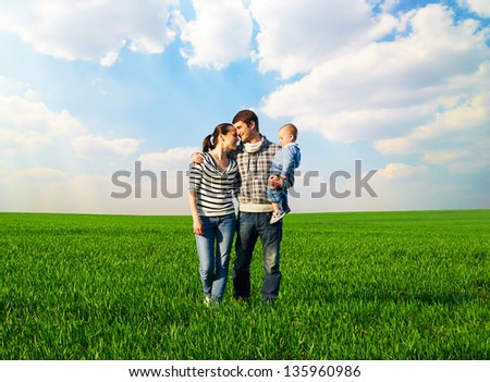 full-length portrait of happy and smiley family at outdoors