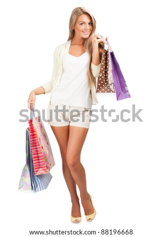 Full length portrait of happy beautiful  woman with colorful shopping bags in her hands