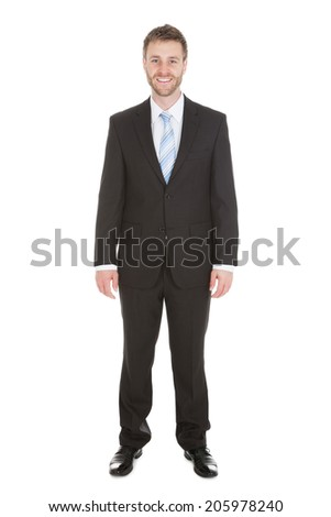 Full length portrait of happy businessman standing isolated over white background - stock photo
