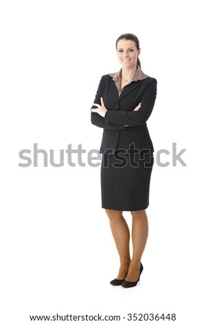 Full length portrait of happy businesswoman standing with arms folded, smiling at camera, cutout on white. - stock photo