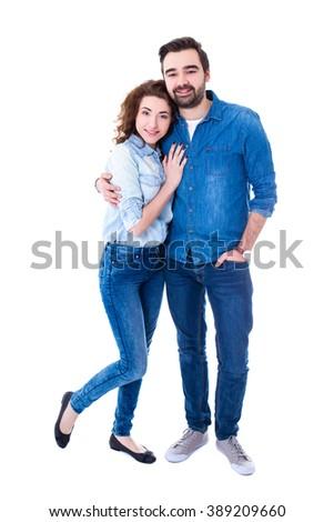 full length portrait of happy couple isolated on white background - stock photo