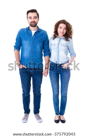 full length portrait of happy couple standing isolated on white background
