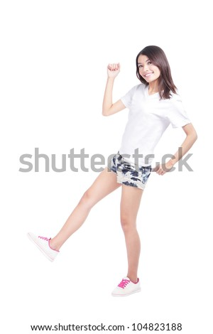 Full length portrait of happy excited girl with white t-shirt and blue jeans isolated over white background, model is a asian woman - stock photo