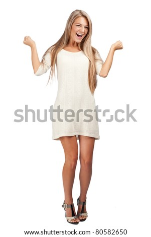 Full length portrait of happy excited woman with raised arms. Over white background