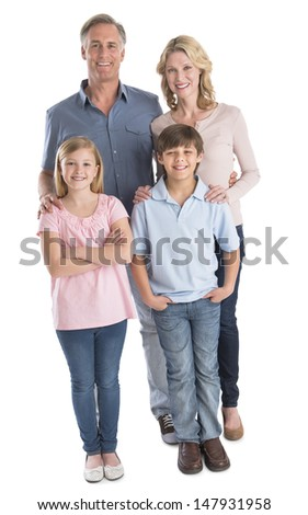 Full length portrait of happy family of four smiling against white background - stock photo