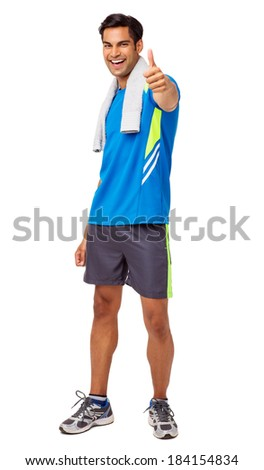 Full length portrait of happy fit man gesturing thumbs up over white background. Vertical shot. - stock photo