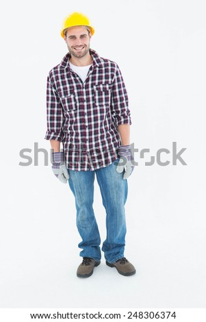 Full length portrait of happy male repairman wearing hard hat on white background - stock photo