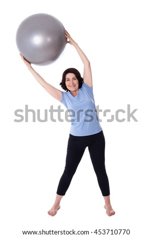 full length portrait of happy mature woman doing exercises with fitness ball isolated on white background