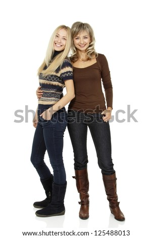 Full length portrait of happy mother and teen daughter, over white