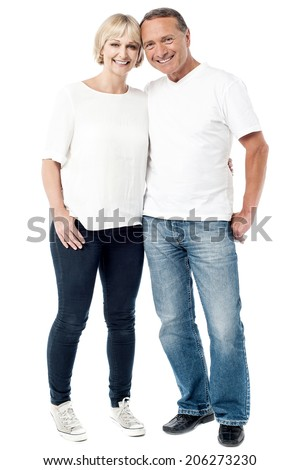 Full length portrait of happy smiling couple standing - stock photo