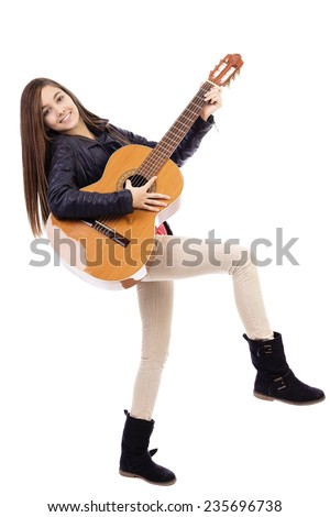 Full length portrait of happy teenage girl playing guitar isolated on white background  - stock photo