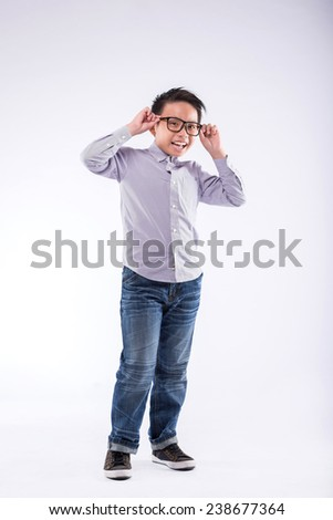 Full-length portrait of happy Vietnamese boy in glasses - stock photo