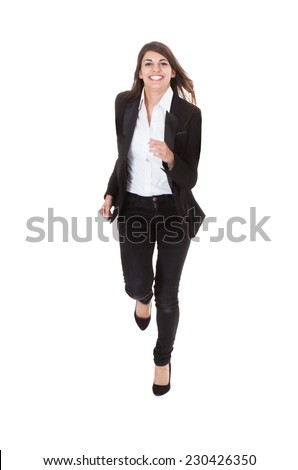 Full length portrait of happy young businesswoman running over white background - stock photo
