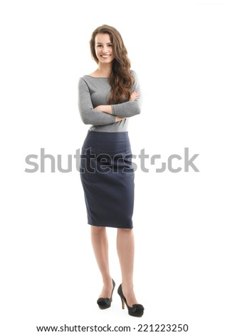 Full length portrait of happy young businesswoman standing against white background.