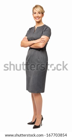 Full length portrait of happy young businesswoman with arms crossed over white background. Vertical shot. - stock photo