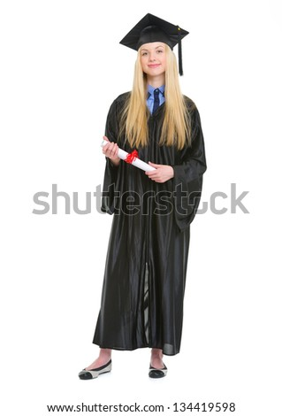 Full length portrait of happy young woman in graduation gown with diploma