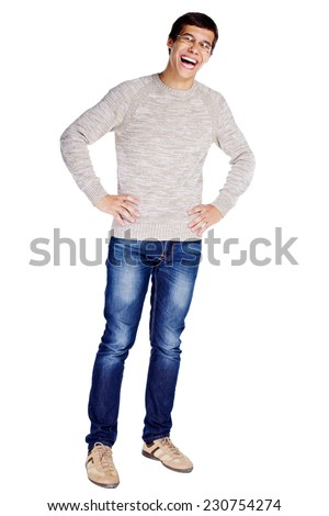 Full length portrait of laughing young man in glasses and beige sweater with hands on hips isolated on white background  - stock photo