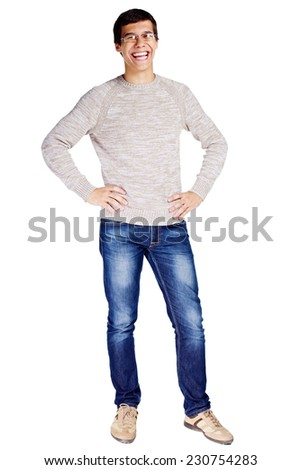 Full length portrait of laughing young man in glasses and beige sweater with hands on hips isolated on white background