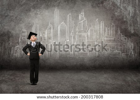 Full-length portrait of little student with hands on hips against modern city drawing. Concept of graduation and dreams - stock photo
