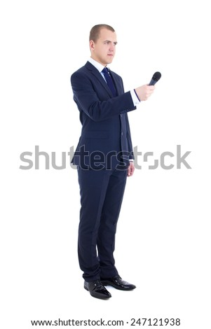 full length portrait of male reporter with microphone isolated on white background - stock photo