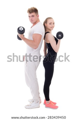 full length portrait of man and woman in sportswear doing exercises with dumbbells isolated on white background - stock photo