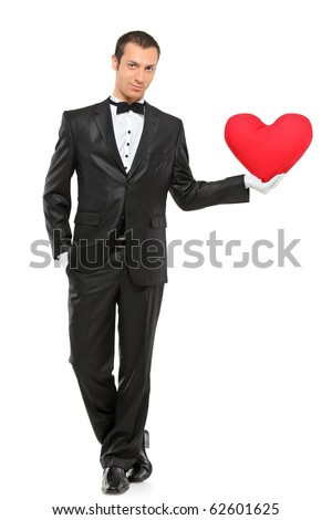 Full length portrait of man holding a red heart-shaped pillow isolated against white background - stock photo