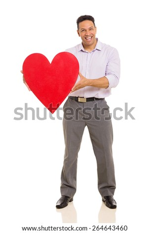 full length portrait of man presenting red heart symbol - stock photo