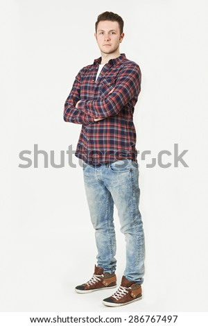 Full Length Portrait Of Man Standing In Studio On White Background