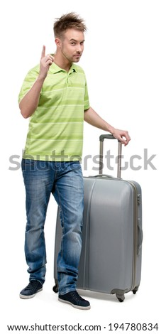 Full-length portrait of man with silver suitcase attention gesturing, isolated on white. Concept of traveling and cool vacations - stock photo