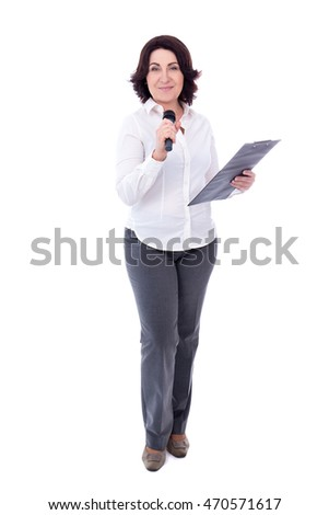 full length portrait of mature female reporter with microphone and clipboard isolated on white background
