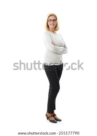 Full length portrait of mature woman standing against white background.  - stock photo