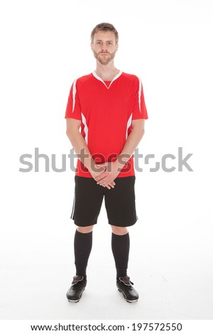Full length portrait of mid adult man in sportswear standing over white background - stock photo