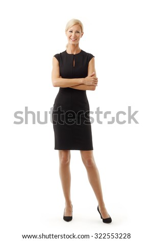 Full length portrait of middle age businesswoman standing against white background while looking at camera and smiling.  - stock photo
