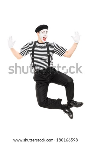 Full length portrait of mime artist jumping with joy isolated on white background - stock photo