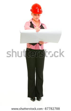 Full length portrait of modern architect woman checking plans isolated on white - stock photo
