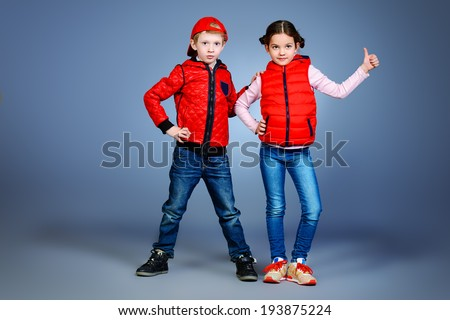 Full length portrait of modern boy and girl standing together. Fashion.  - stock photo