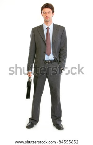 Full length portrait of modern businessman with briefcase isolated on white