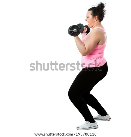 Full length portrait of obese girl doing workout with weights.Isolated on white background.