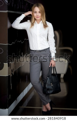 Full length portrait of office employee, attractive confident young business woman in white shirt - stock photo