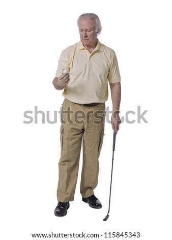 Full length portrait of old man golfer holding golf ball against white background