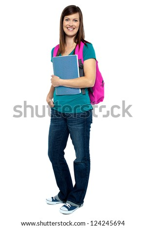 Full length portrait of pretty college girl carrying pink backpack. Casual studio shot. - stock photo