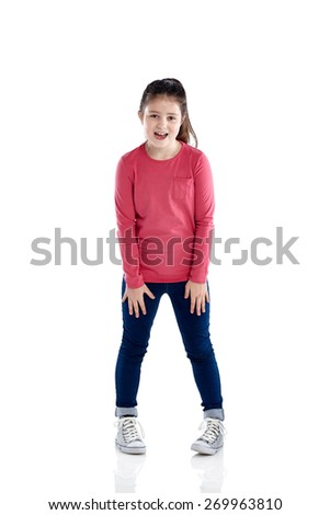 Full length portrait of pretty young girl laughing on white background - stock photo