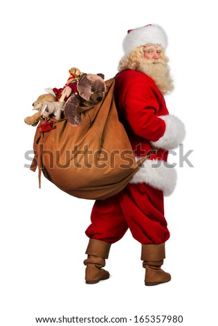Full length portrait of Real Santa Claus carrying big bag full of gifts from behind, isolated on white background - stock photo