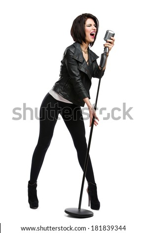 Full-length portrait of rock musician wearing leather jacket and keeping static microphone, isolated on white. Concept of rock music and rave - stock photo