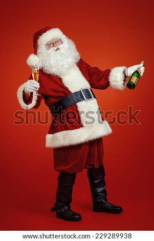 Full length portrait of Santa Claus. Over festive red background.  - stock photo