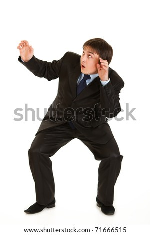 Full length portrait of scared young businessman isolated on white - stock photo