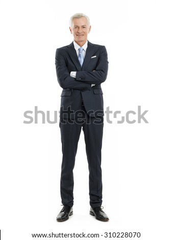 Full length portrait of senior businessman standing against white background with arms crossed.  - stock photo